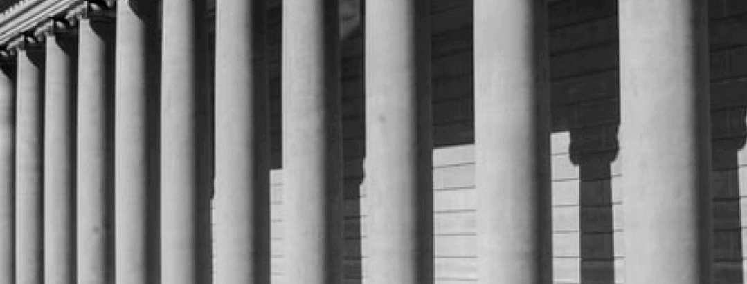 white pillars in front of a courthouse